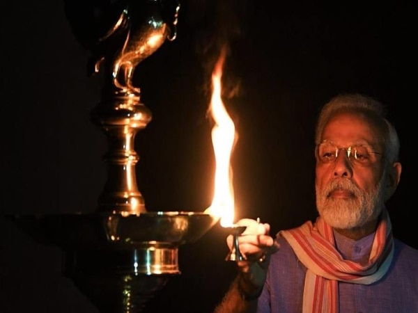 PM Modi lights lamp at residence, tweets pictures | 9pm-9min thumbnail